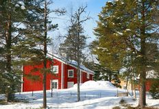 House in forest. Red house in a winter forest Royalty Free Stock Images