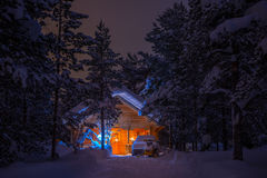 House in the Forest at Night Royalty Free Stock Image