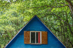 House in Forest. Roof of wooden house in forest Royalty Free Stock Images