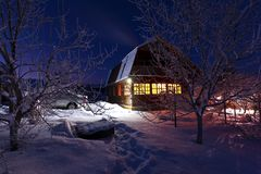 House in forest. Winter light Stock Image
