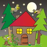 House in forest. The house in the woods. Night picture with birds Stock Images