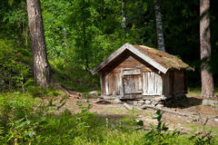 House of forester. Small wooden house of forester on forest margin in Finnish reserve Stock Photography