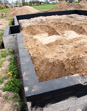 House and foundation. The foundation of a house being filled with sand royalty free stock photography