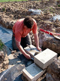 House foundations worker stock images