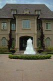 House with Fountain. Grand luxury house / home with beautiful water fountain with manicured garden and trees and circle drive stock photos
