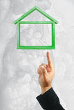 House frame. Business Hand push Green House frame Royalty Free Stock Images