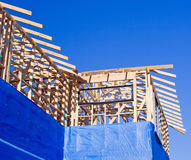 House Frame with foil insulation. House frame under construction with foil insulation partly installed Royalty Free Stock Photo