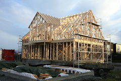 House framework. Framework of house under construction with scaffolding Stock Image