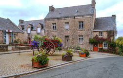 House in the French brittany. House  in the French brittany with courtyard  and flowers on a cloudy day Stock Photos