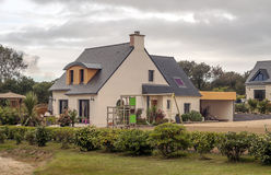 House in the French brittany. House  in the French brittany with garden and flowers on a cloudy day Stock Photo