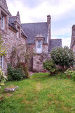 House in the French brittany. House  in the French brittany with garden and flowers on a cloudy day. It´s a vertical picture Stock Images