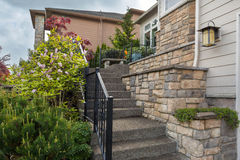 House Front Cultured Stone Work Siding and Stair. House frontyard cultured veneer stone work siding and rod iron stairs Royalty Free Stock Photos