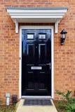 House Front Door. Black Front Door of a Red Brick London Town House Stock Image