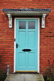 House Front Door. Front Door of an English Red Brick House Stock Photo