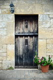 House Front Door. Wooden Front Door of a Beautiful Old House Stock Photo