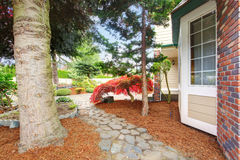 House front yard. View of stone walkway Stock Photos