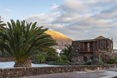 House - Fuerteventura, Canary Islands, Spain. Desert landscape - hill - village (house - typical canarian architecture) - sunset - Fuerteventura, Canary Islands stock photo
