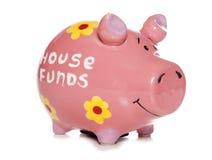 House funds savings piggy bank. Cutout Stock Images