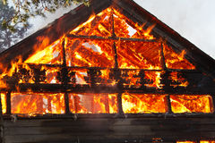 House gable engulfed in flames Stock Photos