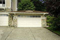 House garage with stone trim and tile roof stock photo