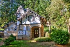 House in the garden stock photos