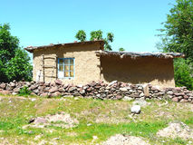 A house in the garden. The house Keeper in pomegranate garden city Nurek Tajikistan Royalty Free Stock Images