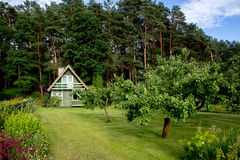 House in Garden Stock Photo