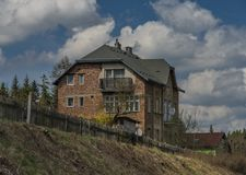 House with garden near Karlovy Vary Brezova station. In spring sunny day Royalty Free Stock Photos