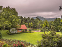 House in garden. Top view of mountain home surrounded by green grass, trees and gardens in summer - Gramado - Rio Grande do Sul - Brazil Stock Photos