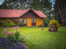 House in garden. View of mountain home surrounded by green grass, trees and gardens in summer - Gramado - Rio Grande do Sul - Brazil Royalty Free Stock Photography