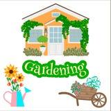 House, garden wheelbarrow, watering can and garden plants. Royalty Free Stock Photo