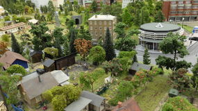 The house, gardens and orchards. Fragment of the exposition of the Museum Grand model of Russia in St. Petersburg.The house, gardens and orchards Royalty Free Stock Photography