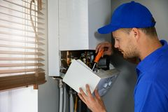 Free House Gas Heating Boiler Maintenance And Repair Service Stock Photography - 153386372
