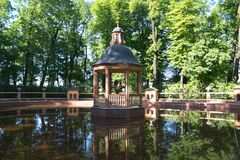 House-gazebo standing on the water in the pond stock photography