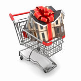 House gift with bow in shopping cart Royalty Free Stock Images
