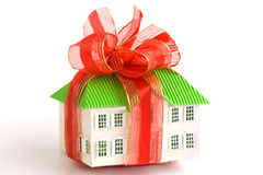 House-gift. House Concept: Architectural Model of Cosy House with Red Ribbon like a Present Stock Image