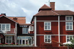 House  with gingerbread. Red house with white corners Royalty Free Stock Photo