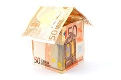 house gjorda pengar arkivbilder