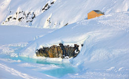 House on glacier in Greenland. In spring time Royalty Free Stock Photography