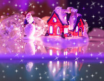 House with glowing windows. Christmas card Royalty Free Stock Photography