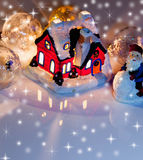 House with glowing windows. Christmas card Royalty Free Stock Image