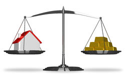 House and gold bars on scales Stock Image