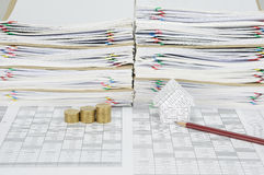 House and gold coins have paperwork and envelope as background Stock Image