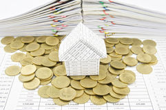 House on gold coins Stock Images