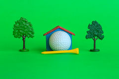 A house by a golf ball surrounded by trees and greenery. A house with a golf ball surrounded by trees and greenery , is the symbol of the presence of a golf Stock Images