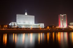 House of Government (The White House) in Moscow, Russia, at nigh. T. Seen as reflected in the Moscow River Stock Photo