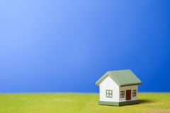 House on a grass. Conceptual image Royalty Free Stock Photos
