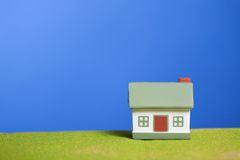 House on a grass. Conceptual image Royalty Free Stock Image
