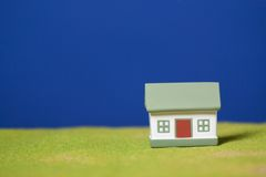 House on a grass. Conceptual image Stock Photo