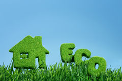 House from grass and word eco Stock Images